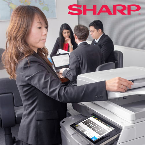 Sharp image of an employee using a Sharp Multifunction Printer
