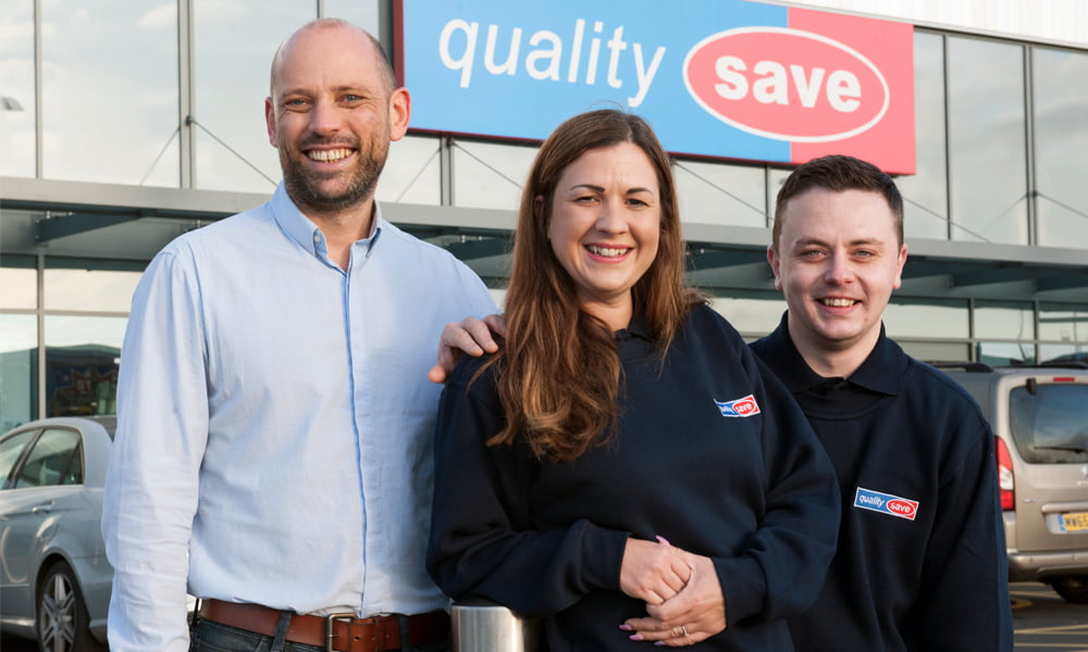 Quality Save Managing Director Ric Rudkin with two employees outside the Walkden Retail store