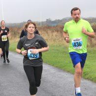 Sarah and Chris Powell running