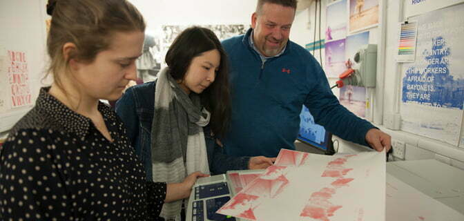 Kingston University students using the risograph