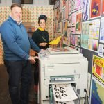 Gabriella Marcella and Daniel Bridgeman stood with the RISO printer