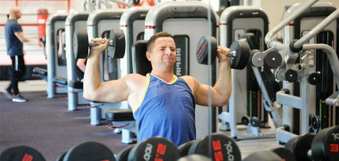 Man using weight at Life Leisure