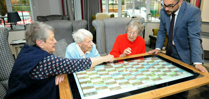 Elderly ladies using the interactive touchscreen table